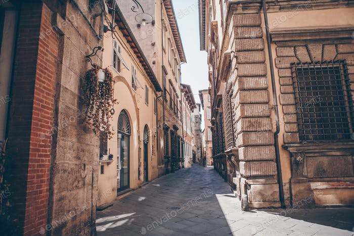 Old beautiful empty narrow streets in small city of Lucca in Italy