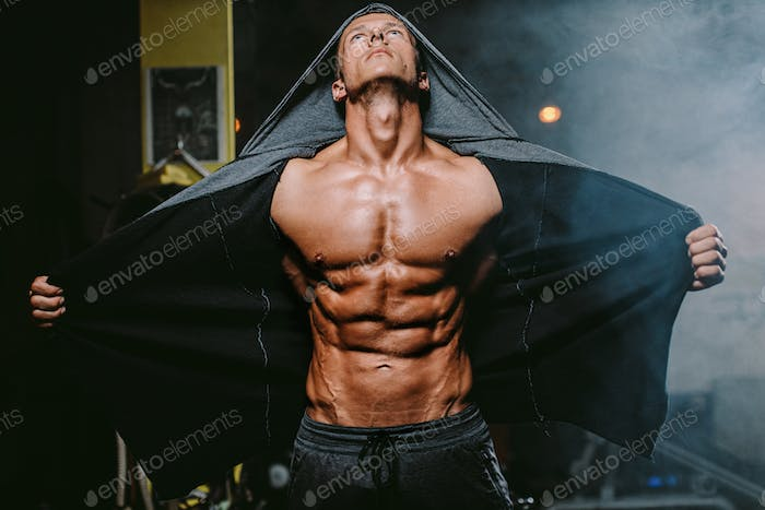 Brutal muscular man showing  Muscles body with abs