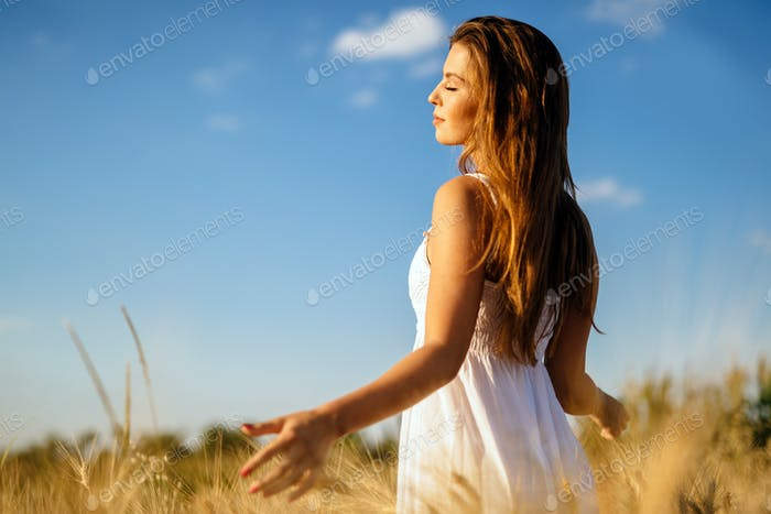 Beautiful woman in barley fields