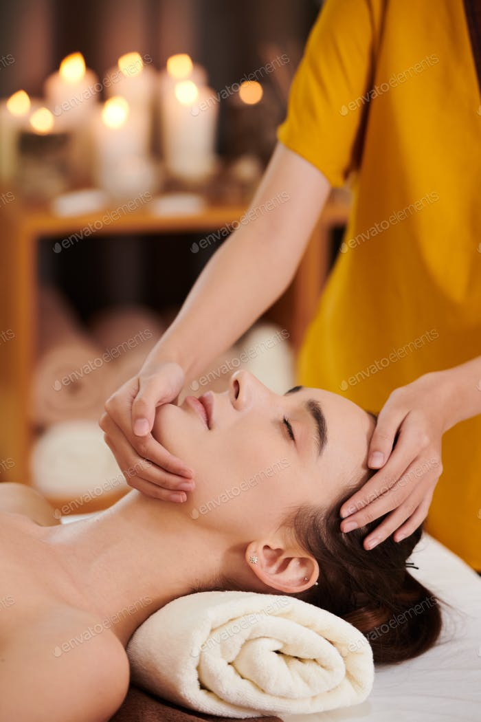 Woman getting face massage