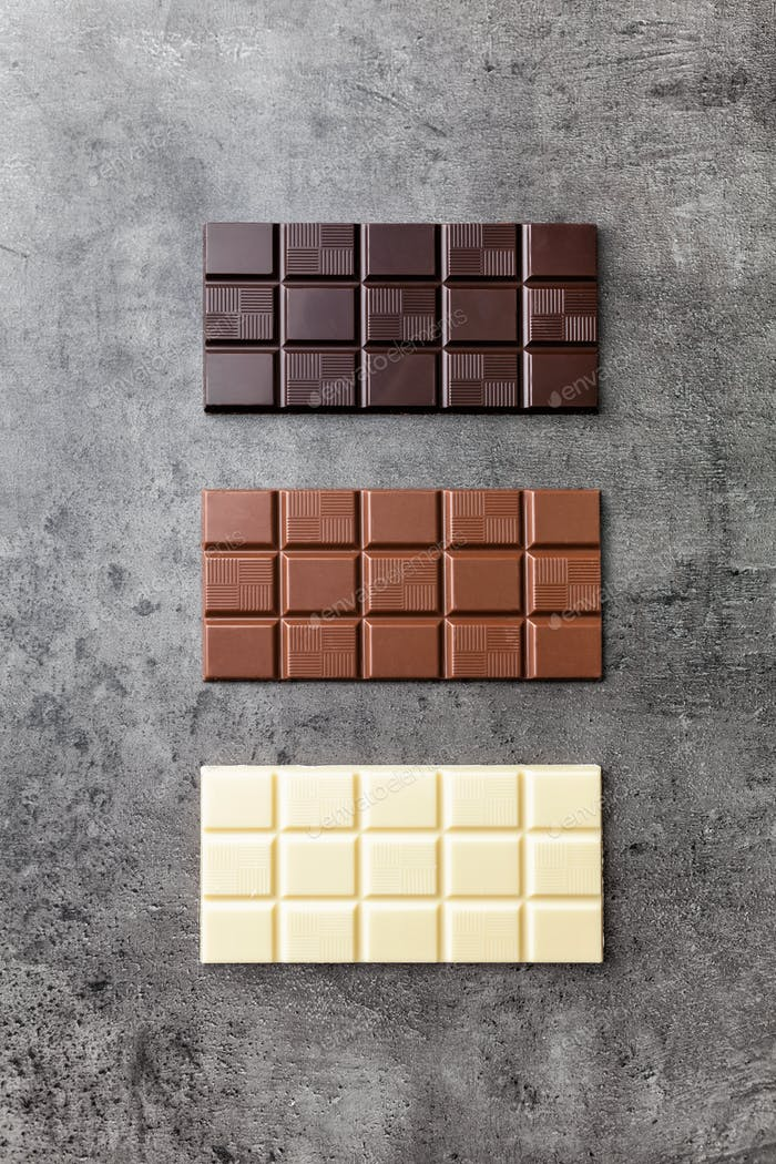 Delicious variety of chocole on rustic background