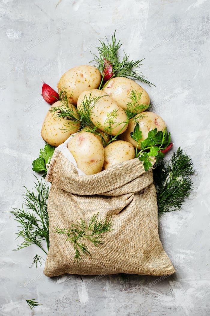Raw potatoes in a linen bag
