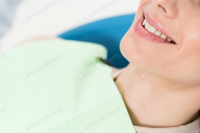 Smiling woman at check-up in modern dental clinic