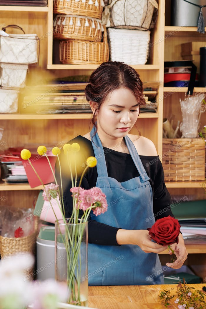 Florist cutting rose leaves