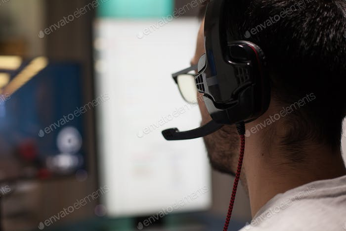 Close up concentrated man playing professional shooter games