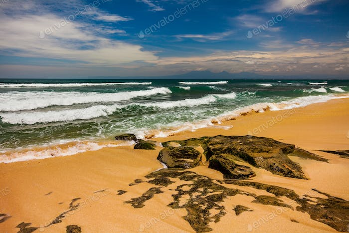 Bali seascape with huge waves at beautiful hidden white sand beach