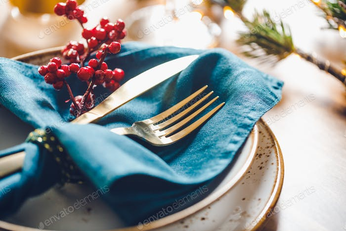 Festive table setting with winter decor