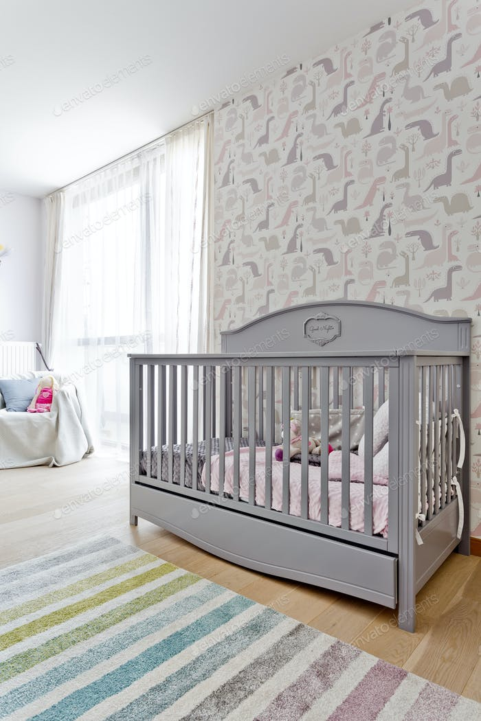 Bright child room with the stylish cot