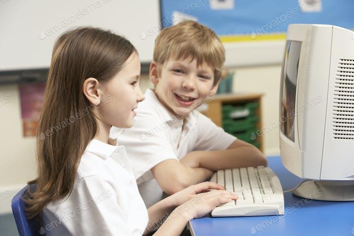 Schoolchildren In IT Class Using Computer