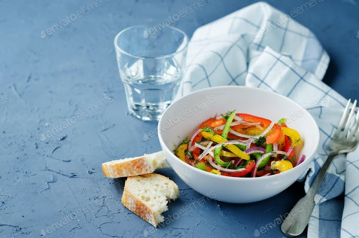Multicolored bell peppers red onion salad