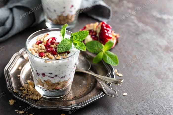 Chia pudding parfait with pomegranate, granola and light greek yogurt. Healthy eating