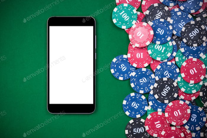 Mobile phone and casino chips on poker table