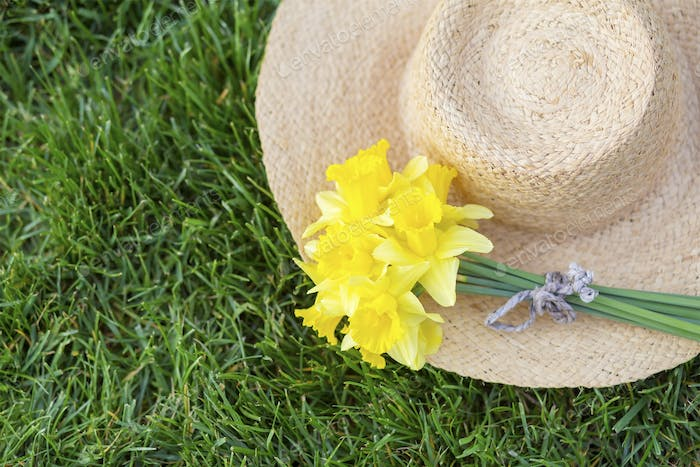Easter daffodil flower on a straw hat