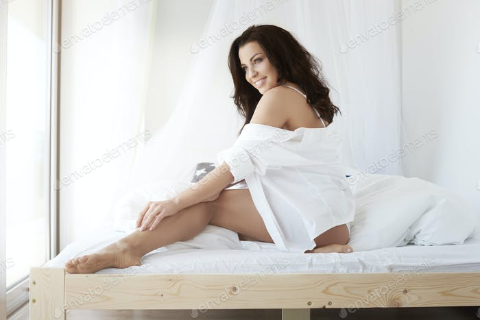 Woman in underwear in the bedroom