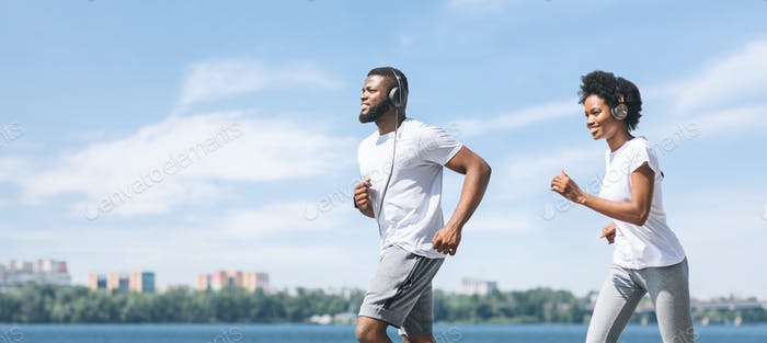 Afro Couple Jogging Outdoor Along River Embankment In The Morning