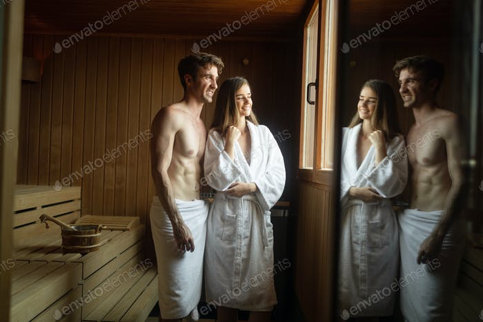 People pursuing healthy lifestyles relaxing in sauna
