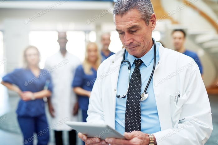 Portrait of doctor with tablet in clinic