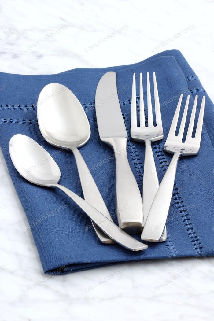 beautiful silverware on fine napkin