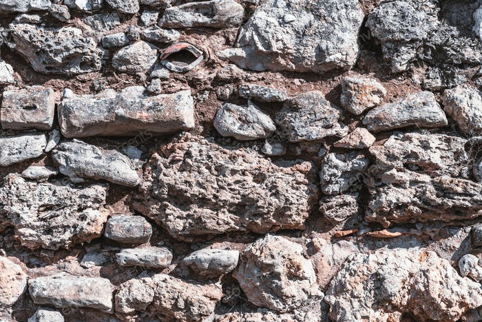 The texture of a stone wall