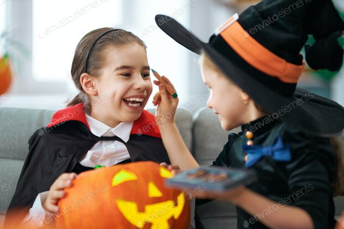 girls with carving pumpkin