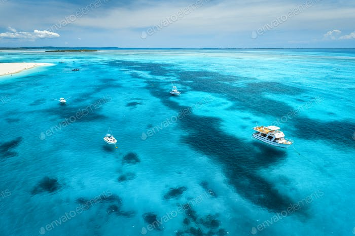 Aerial view of the yachts, fishing boats in clear blue water
