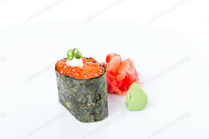 Gunkan sushi stuffed with red salmon caviar.