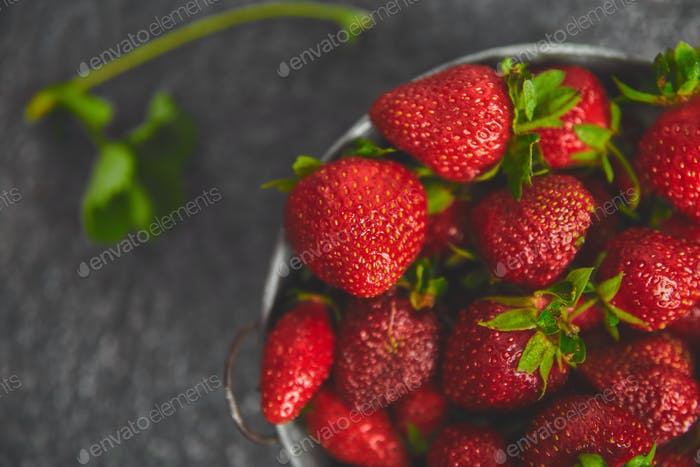 Strawberries in white basket. Fresh strawberries.