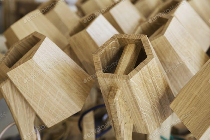Close up of hexagonal, wooden furniture elements.