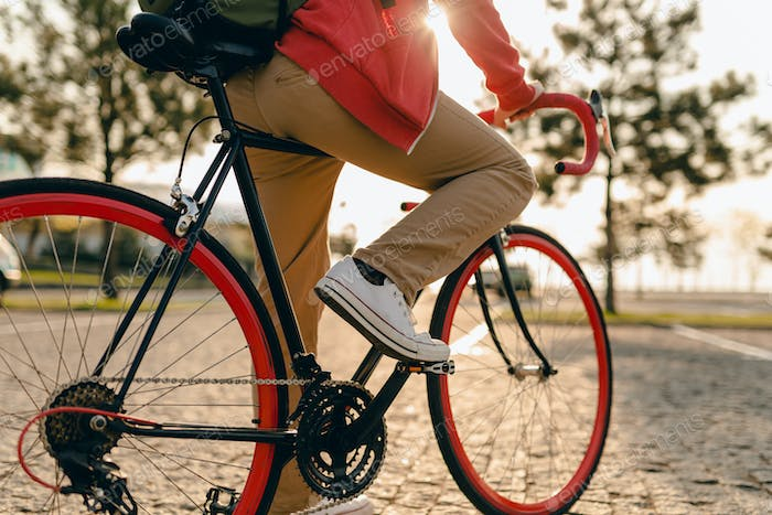 handsome bearded man traveling with bicycle in morning