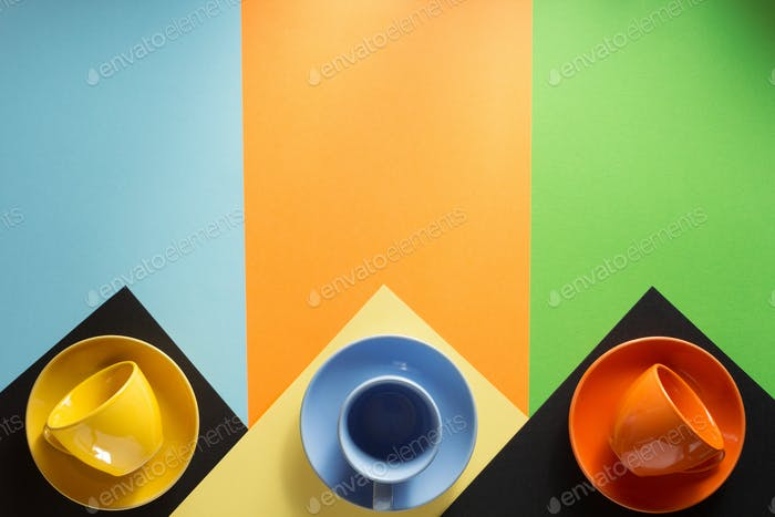 cup and saucer at colorful background
