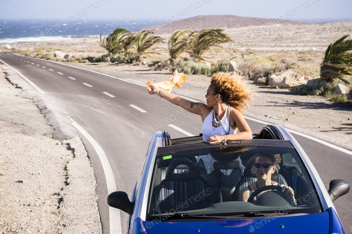 Travel and happy freedom lifestyle young people concept with couple of curly nice ladies traveling