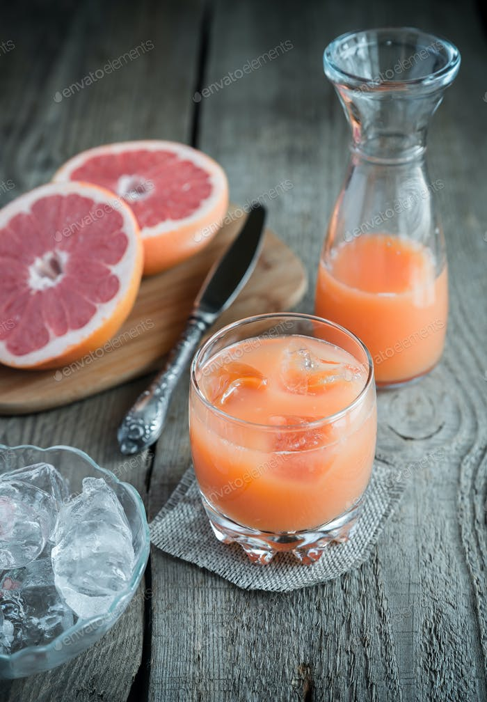 Grapefruit juice on the wooden table