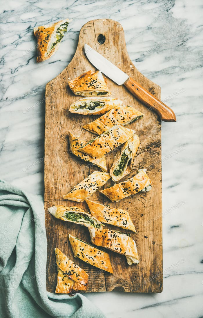 Freshly baked Turkish borek roll cut in slices