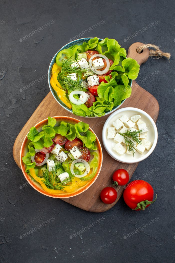 top view vegetable salad with cheese cucumbers and tomatoes on a dark background meal health fit