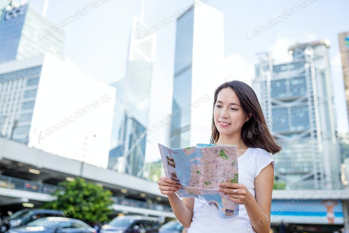 Woman using city map to find her destination