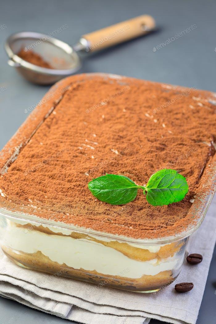 Traditional italian Tiramisu dessert cake in a glass form, decor