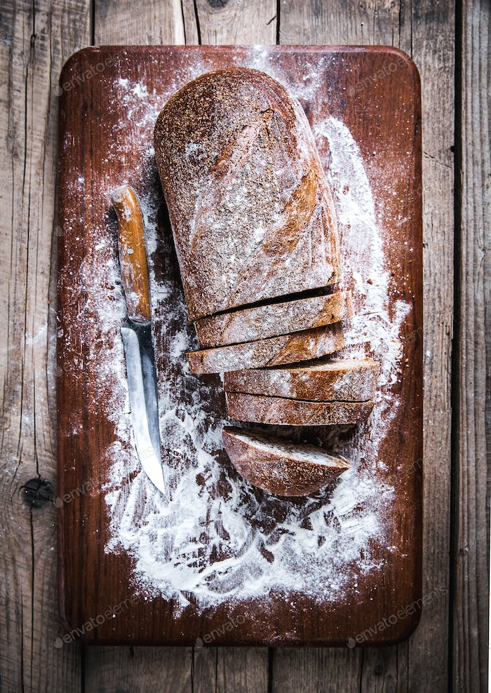 food. sliced rye bread on a wooden background. Bread flour