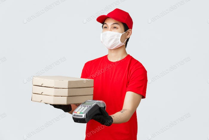 Contactless delivery, safe purchase and shopping during coronavirus concept. Friendly courier in red