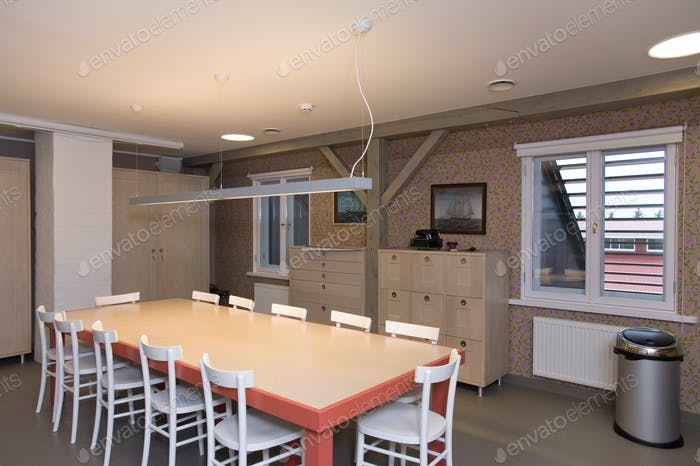 Large dining table with chairrs in apartment.