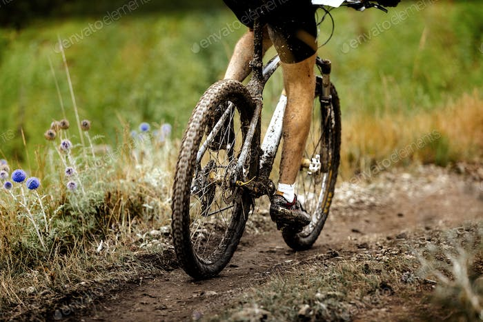 athlete cyclist dirty mountain bike