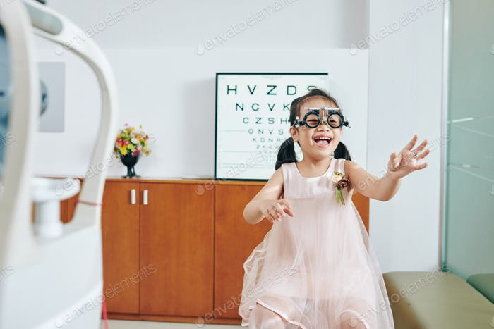 Laughing girl in test glasses