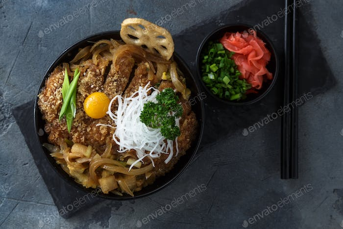 Rice bowl topped with fried pork cutlet Katsudon, tonkatsu donburi, japanese cuisine