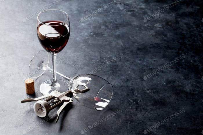 Red wine glasses and corkscrew