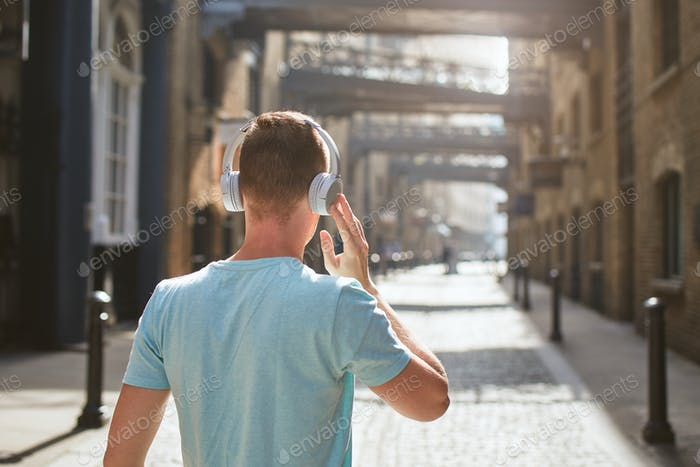 Thumbnail for Man with headphones listening music