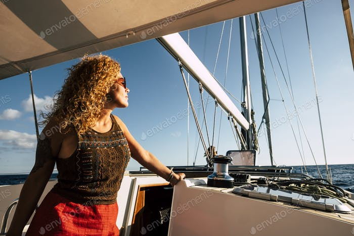 Happy caucasian woman enjoy tourism transport in sail boat