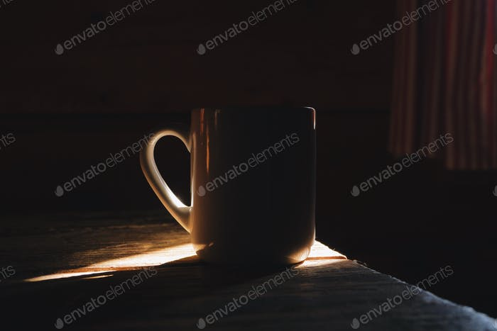Thumbnail for cup of coffee in a morning light, rustic wooden cottage interior