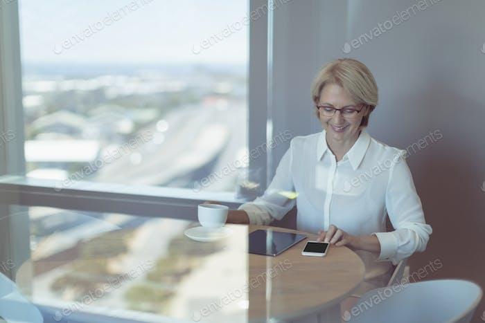 Businesswoman using smart phone