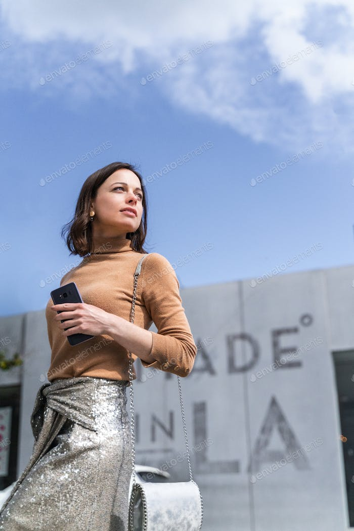 Beautiful girl with a phone in Los Angeles