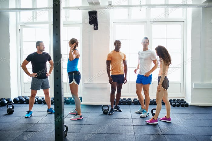Diverse group of people talking together after a gym workout