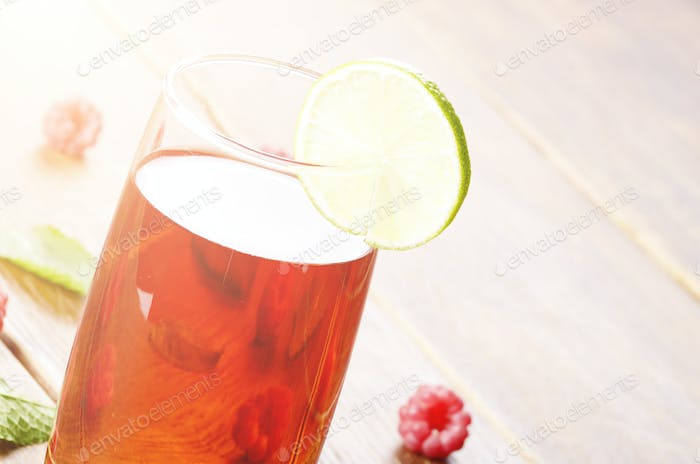 Lime and Mint raspberry Fruit Beer on wooden table